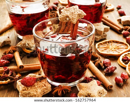 Glasses with hibiscus tea, spices and berries. Shallow dof. - stock photo