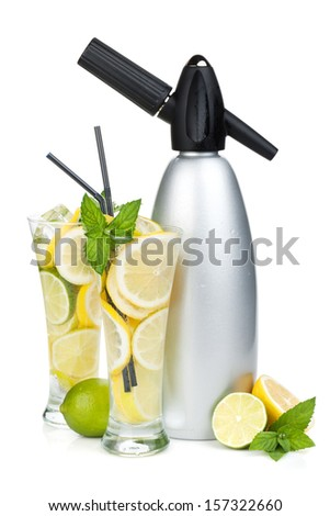 Glasses with homemade lemonade and siphon. Isolated on white background - stock photo