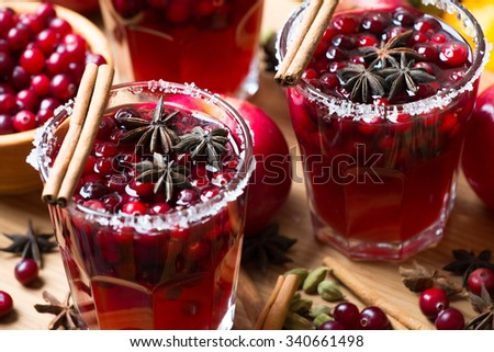 Glasses with hot punch for winter and Christmas with fruits and wine. Mulled wine  - stock photo