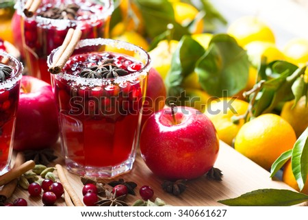 Glasses with hot punch for winter and Christmas with fruits and wine. Mulled wine