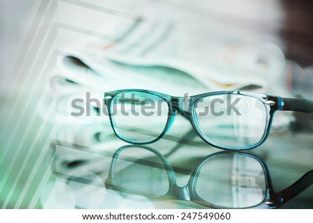 Glasses with newspaper - stock photo