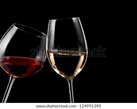 Glasses with red and white wine - stock photo