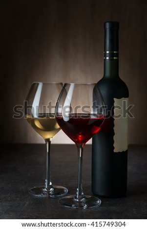Glasses with red and white wine n bar