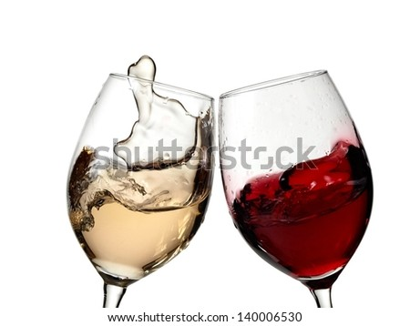Glasses with red and white wine plash - stock photo