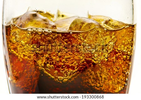 Glasses with soda and ice cubes - stock photo