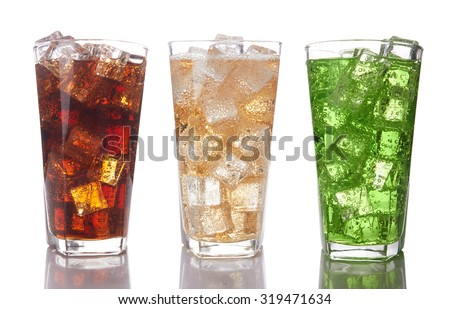 Glasses with sweet drinks with ice cubes isolated on white background - stock photo