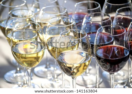 glasses with white and red wine close-up before party in cafe  - stock photo