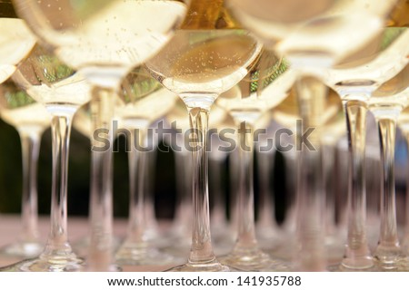 Glasses with wine on table - party background - stock photo