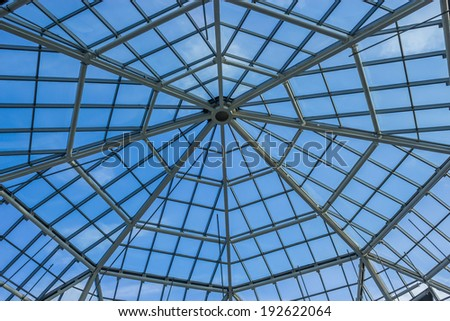 Glassroof of the building over blue sky
