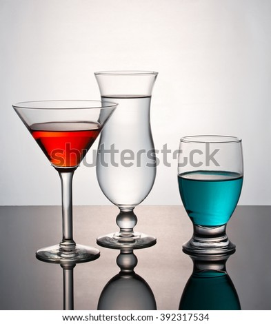 Glassware with color and transparent liquid. - stock photo