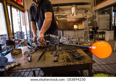 Glassworks glass manufacturing process  - stock photo