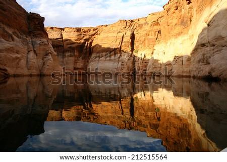 Glassy conditions in Navajo Canyon at Lake Powell in Northern Arizona, Southern Utah. - stock photo