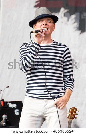 Glastonbury, Somerset, UK - June 28, 2015 - Stuart Murdoch of Belle and Sebastian playing Glastonbury Festival's Other Stage - stock photo