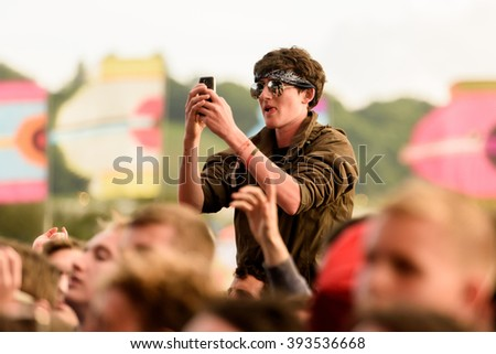 Glastonbury, Somerset, UK - June 26th 2015: Festival goer filming The Courteeners performing on the Other Stage at Glastonbury Festival 2015.