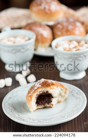 Glazed buns with chocolate filling - stock photo