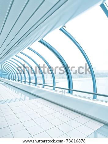 Glazed corridor in office center - stock photo