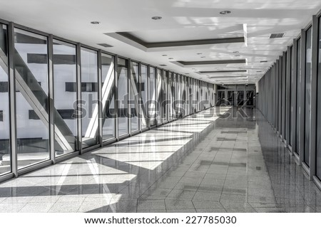 glazed passage between buildings in simple urban style - stock photo