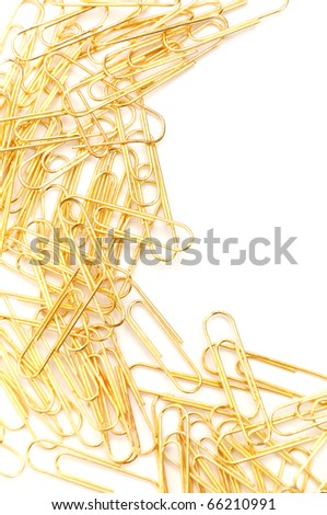 Gleaming golden paperclip isolated on white