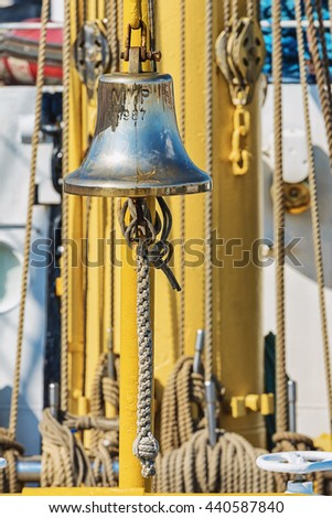 gleaming ship's bell aboard a ship moored in the port of Amsterdam