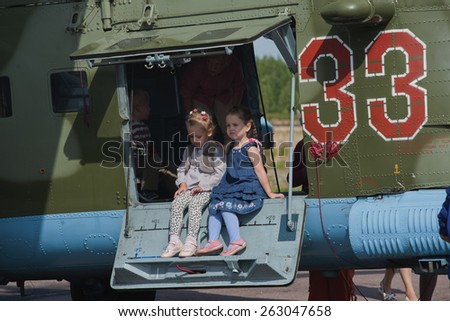 Glebychevo Russia on 12 August 2012. Day air force in the village of Glebychevo military parade. Children near the helicopter - stock photo