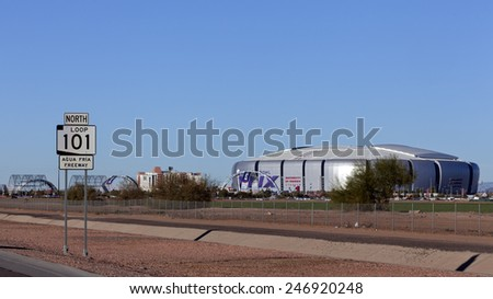 GLENDALE, AZ - JANUARY 24, 2015: One week before Super Bowl XLIX, highway sign Loop 101 near University of Phoenix Cardinal Stadium where New England Patriots play Seattle Seahawks on February 1 2015  - stock photo