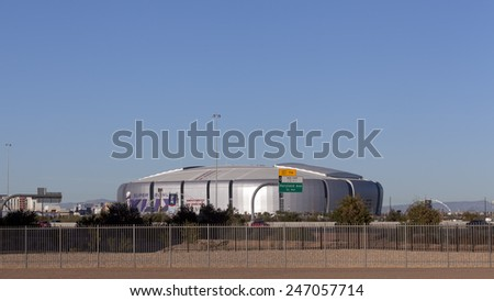 GLENDALE, AZ - JANUARY 24, 2015: University of Phoenix Cardinal Stadium getting ready for Super Bowl XLIX as seen across highway Loop 101, Glendale, Arizona. Seahawks play Patriots on February 1, 2015 - stock photo
