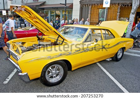 GLENDALE/CALIFORNIA - JULY 19, 2014: 1967 Chevrolet Chevelle owned by Aram Kazazian at the Glendale Cruise Nights Car Show July 19, 2014 Glendale, California USA  - stock photo