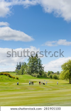 "GLENEAGLES, SCOTLAND - MAY 26, 2015: golfers playing The King's Course at the Gleneagles Hotel and resort in Perthshire, Scotland.  Gleneagles was awarded  ""Best Golf Resort in the World"" for 2014"