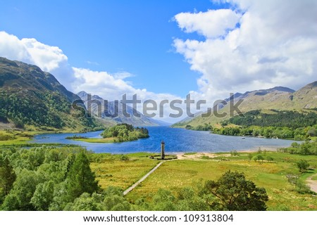 Glenfinnan Monument and Loch Shiel lake spring landscape. Lochaber, Highlands of Scotland, United Kingdom, Europe - stock photo