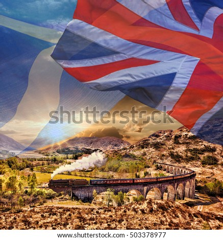 Glenfinnan Railway Viaduct in Scotland with the Jacobite steam train against scottish ang british flags
