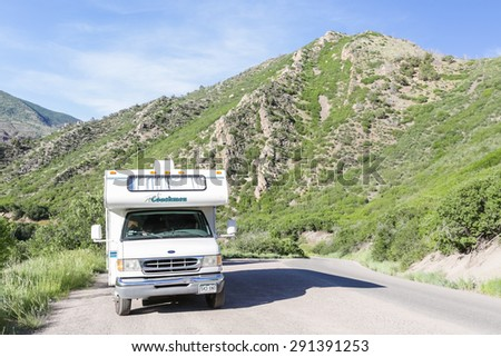 Glenwood Springs, Colorado, USA-June 20, 2015. Motorhome parked on the side of South Canyon Creek near Glenwood Springs, Colorado.