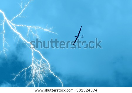 Glider in flight in the sky with clouds - stock photo