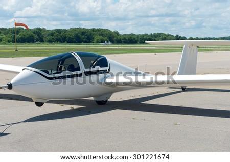 glider or sailplane on runway at municipal airport in faribault minnesota - stock photo