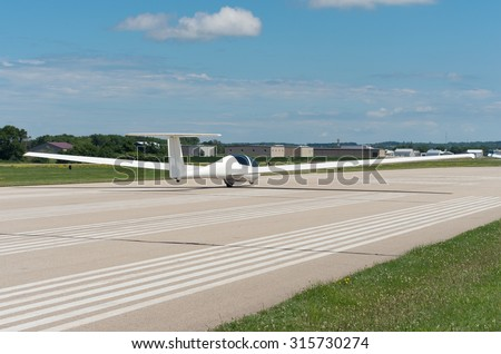 glider or sailplane on runway ready for takeoff at airport in faribault minnesota - stock photo