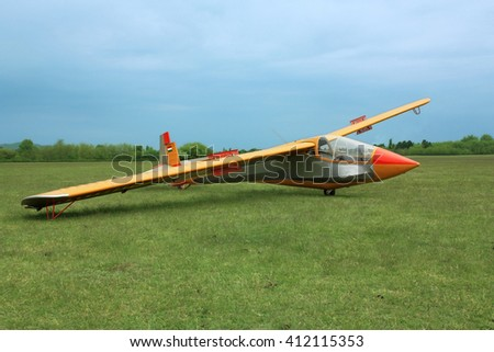 Glider plane on green grass with Hungarian flag