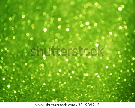 Glitter bokeh abstract green background.