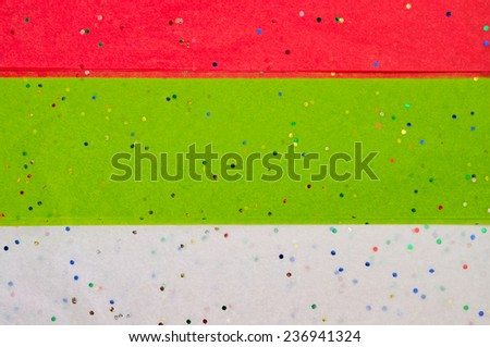 Glitter Covering Red, Green and White Tissue Wrapping Paper for your Background - stock photo