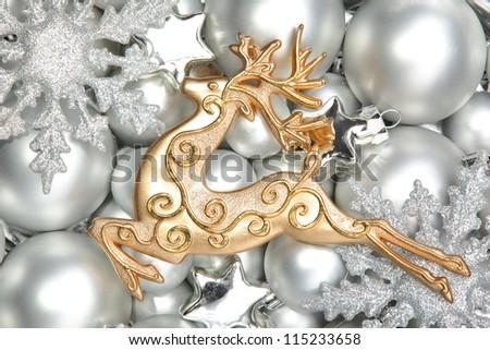 Glitter deer shaped ornament on silver balls. - stock photo