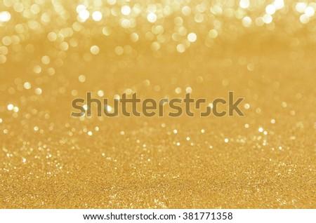 glitter golden lights background. defocused. - stock photo