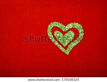 glitter heart on red color surface texture background  - stock photo