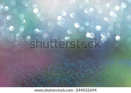 glitter vintage lights background. blue, green and purple. defocused  - stock photo