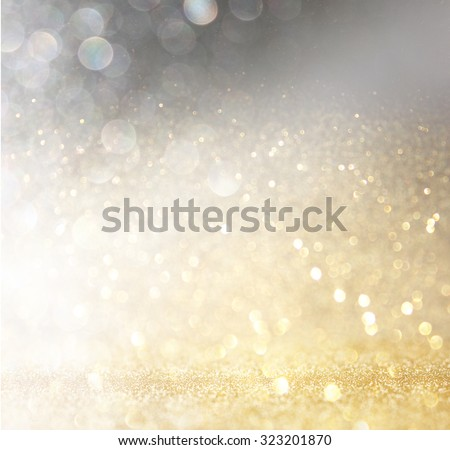 glitter vintage lights background. gold, silver, and black. de-focused.  - stock photo
