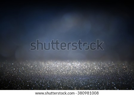 glitter vintage lights background. gold, silver, blue and black. de-focused.  - stock photo