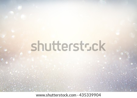 glitter vintage lights background. gold, silver, blue and white. de-focused. - stock photo
