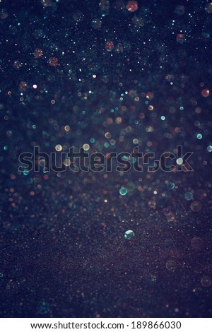 glitter vintage lights background. light gold and black. defocused. - stock photo