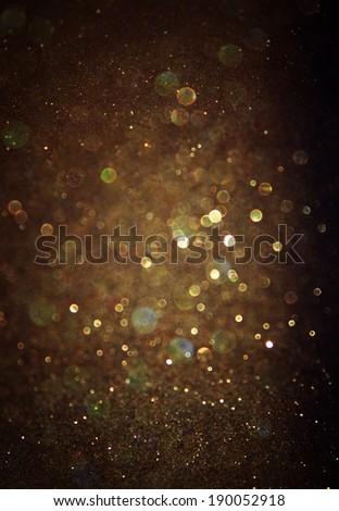 glitter vintage lights background. light gold and black. defocused - stock photo
