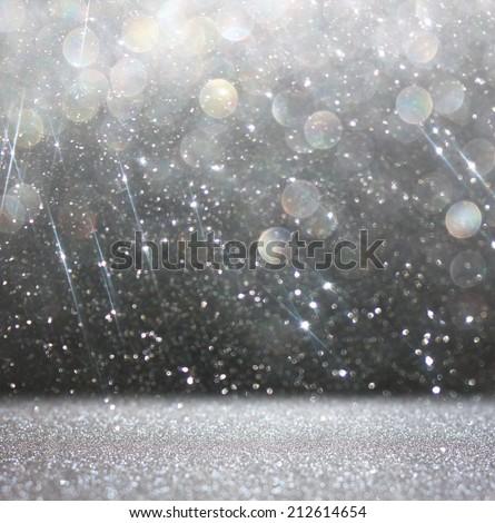 glitter vintage lights background. light silver and black. defocused - stock photo