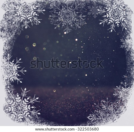 glitter vintage lights background. light silver and black. defocused. with snowflakes overlay  - stock photo