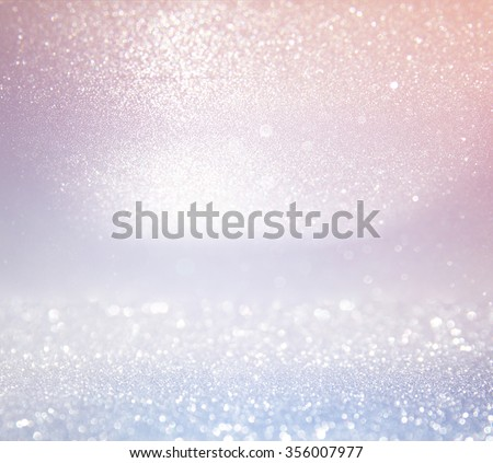 glitter vintage lights background. light silver, and pink. defocused.