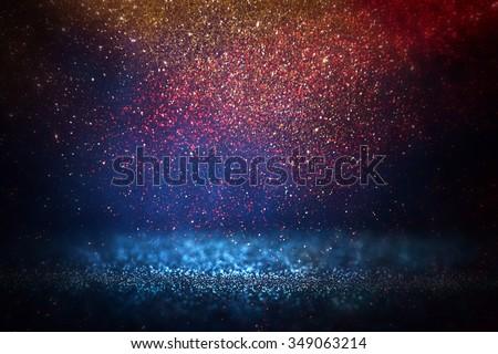 glitter vintage lights background. light silver, gold, red, blue and black. defocused.  - stock photo